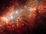 NGC 1569: звездные взрывы в маленькой галактике