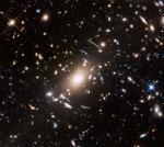 Скопление галактик Эйбелл S1063 и за ним